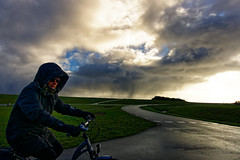 The Cyclist Part Two (Alfred Grupstra) Tags: outdoors sport nature cycling people bicycle sky men oneperson cloudsky road action adventure recreationalpursuit travel lifestyles grass ruralscene women freedom