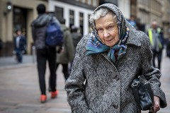 Growing Old Gracefully (Leanne Boulton) Tags: urban street candid portrait portraiture streetphotography candidstreetphotography candidportrait streetportrait eyecontact candideyecontact streetlife old elderly woman female lady face eyes expression mood emotion feeling gentle smile wrinkles headscarf winter warmth character personality tone texture detail depthoffield bokeh naturallight outdoor light shade city scene human life living humanity society culture lifestyle people canon canon5dmkiii 70mm ef2470mmf28liiusm color colour glasgow scotland uk