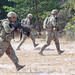 U.S. Soldiers run toward their objective during squad training at Klong  Kluea, Thailand