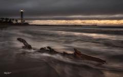 Stormy morning by Hillsboro Inlet. (MyKeyC) Tags: wwwfacebookcommikecohen182 michaeljcohen hillsboroinlet atlantic ocean inlet sunrise cloudy dawn driftwood mykey4photogmailcom flickrcomphotosmykeyc mmykeyyahoocom log lighthouse instagramcommykeycohen