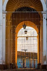 Trinidad, Cuba (kuhnmi) Tags: tor gitter grid arc torbogen durchgang sun eveningsun abendsonne architecture architektur colonial kolonialarchitektur archway light licht travelphotography reisefotographie trinidad cuba kuba