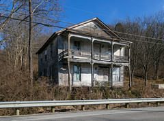 Boyd Building — Levanna, Ohio (Pythaglio) Tags: boyd building ripley ohio unitedstates us structure frontgabled historic commercial twostoryporch levanna browncounty trees cables wires guardrail road pavement 22windows spandrels brackets diamondshapedvent abandoned vacant dilapidated woodsiding frame clapboard threebay twostory