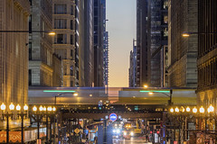 Green Line Train Through Downtown Chicago (Sam Wagner Photography) Tags: twilight long exposure el elevated train metro metropolis downtown chicago zoom telephoto detail blur traffic skyscrapers buildings architecture abstract city cityscape close up illinois urban transportation dusk