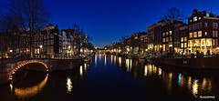 Amsterdam. (alamsterdam) Tags: amsterdam canal bridges night longexposure reflection boats bikes people sky restauarant