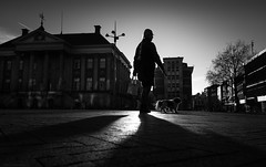 Glowing with her friend ( #ThatInnerCityGlow ) by DillenvanderMolen #MrOfColorsPhotography #PortfolioOfColors MrOfColors.com (mrofcolorsphotography) Tags: black blackandwhite blackandwhitephotography blackandwhitephoto photooftheday photographer photography photo photos cityphotography city cityphotographer canonnederland canonphotography canon fotografie foto day daytime light fotosipkes mrofcolorsphotography mrofcolors mrofcolorscom portfoliofocolors portfolio portfolioofcolors streetphotography street streetphotographer streets cityhall woman walking dog animal sunlight sun sunny sunshine contrast contrasty congrete blackandwhiteportrait dillenvandermolen canoneosr groningen netherlands holland dutch flickr 500px 500pxstudio absoluteblackandwhite