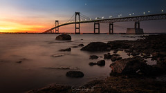 Kiss of Light (Simmie | Reagor - Simmulated.com) Tags: 2019 bridge claibornebridge claibornepellnewportbridge connecticutphotographer d750 dawn february landscapephotographer longexposure lowtide naturephotographer nikon peaceful rhodeisland sunrise taylorpointlookout winter digital narragansett narragansettbay rockybeach water greatphotographers