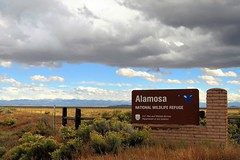 Incoming! (Patricia Henschen) Tags: colorado rural countryside country sanluisvalley alamosanationalwildliferefuge nationalwildliferefuge alamosacolorado alamosa backroads backroad mountains mountain sign sangredecristo clouds storm