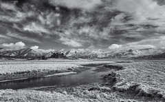 Gone to rack and ruin (David Feuerhelm) Tags: bw blackandwhite noiretblanc monochrome schwarzundweiss blancoynegro nikkor contrast sky landscape wideangle mountains fields clouds building ruin iceland water stream ir infrared nikon d90 sigma1020mmf4056