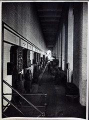 Jolimont Substation Operating Gallery. (Public Record Office Victoria) Tags: railways train electrification blackandwhite archives victoria jolimont substation operating gallery switches machinery volts 1919 man work