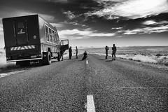 Always straight ahead / Immer geradeaus (Zoom58.9) Tags: street people human truck sky clouds landscape traffic africa trip adventure strasse menschen kkw himmel wolken landschaft verkehr ausflug abenteuer travel reise monochrome bw sw safari canon eos 50d