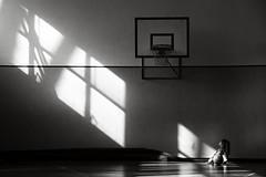 un giorno (duegnazio) Tags: biancoenero blackandwhite bambina palla luce sitting child ball canestro