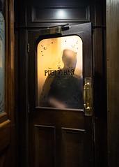 Leaving (Davey Psychotronic) Tags: olympusuk olympus street streetphotography london soho bar door open shadow window opaque yellow