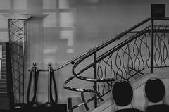 Immediate Seating In The Mezzanine (MPnormaleye) Tags: lobby stairs stairway steps railing chrome theatre monochrome lamp chairs deco streamline decorative curvy utata