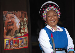 Smiling Woman With Nice Headwear, Lijiang, Yunnan Province, China (Eric Lafforgue) Tags: a7592 adultsonly asia china chinesescript colorpicture costume frontview horizontal lookingatcamera multicolored onepeople oneperson onewomanonly realpeople smile toothysmile traditionaldress waistup womenonly yunnan yunnanprovince lijiang