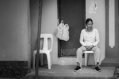 Just Sitting (Beegee49) Tags: street woman filipina sitting watching smile happy planet luminar sony a6000 blackandwhite bw monochrome silay city philippines asia