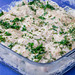 Meat casserole in spicy yogurt sauce on blue background