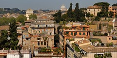 Rooftops of Rome. (edk7) Tags: nikond50 edk7 2007 italy italia lazio latium cittàmetropolitanadiromacapitale rome roma mixeduse multistorey residential commercial architecture building oldstructure column colonnade roof tile city cityscape skyline urban palatinehill palatino stpetersbasilica basilicadisanpietroinvaticano tree evergreen palm church dome lantern campanile belltower tvantenna satellitedish italianstonepine pinuspinea mediterraneancypress cupressussempervirens