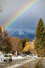 Whitefish Rainbow (wyojones) Tags: montana whitefish feburary wintercarnival paradestreetbig mountainstormcloudsrainbowpeople cars snow