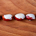 White-red beans on wooden background