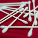 Sterile swabs on a red cloth