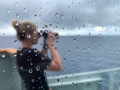 Keeping Watch in the Rain (Royal Canadian Navy / Marine royale canadienne) Tags: boatsbateaux dayjour exteriorextérieur femalesfemmes militariesmilitaires militarypersonnel militaryterms navymarine opcaribbe operationsopérations people shipsnavires watereau horizontal