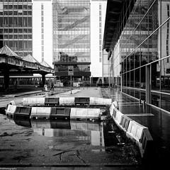 rainy days #2 (fhenkemeyer) Tags: bw architecture rain reflection urban netherlands centraalstation denhaag