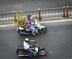 People riding scooters on street in Saigon (phuong.sg@gmail.com) Tags: asia asian bike business busy city congested congestion cross crossroad crowd cycle drive hanoi helmet indochina lifestyle motion motobike motor motorbike motorcycle passenger people pollution ride rider risk road safety saigon scooter sidewalk speed street traffic transport transporter travel urban vehicle vendor vietnam vietnamese