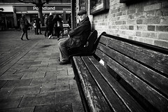 Bench Life (Bury Gardener) Tags: monochrome mono burystedmunds bw blackandwhite suffolk streetphotography street streetcandids snaps strangers candid candids people peoplewatching folks nikond7200 nikon england eastanglia uk 2018 cornhill