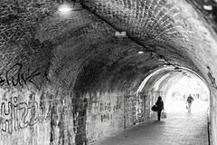 The light at the end of the tunnel (photoday03) Tags: street streetfotografy bn nikon person lights tunnel rock stones