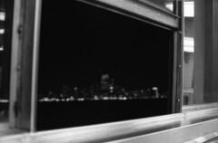 I thought it was NYC but now I am pretty certain it's Ney Jersey :/ (el_horbo) Tags: minolta ilford hp5 kodak hc110 film bw analog nyc newjersey ferry night skyline