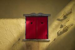 'Casal de Fatima' (Canadapt) Tags: red yellow window wall shadow embellishment name fatima portugal canadapt heart shutter wroughtiron