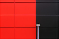 Lamp preferred Black (HWHawerkamp) Tags: duesseldorf germany wall facade abstract architecture grid lamp lamppost red