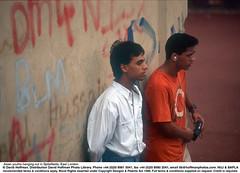 """Asian Youths 1 (hoffman) Tags: asian graffiti graffitti grafitti horizontal loitering young youth bangladesh davidhoffman wwwhoffmanphotoscom london uk davidhoffmanphotolibrary socialissues reportage stockphotos""""stock photostock photography"""" stockphotographs""""documentarywwwhoffmanphotoscom copyright"""