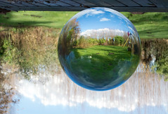 Crystall Ball 1 (Wim Koopman) Tags: crystall ball upside down garden glass blue sky sparkle
