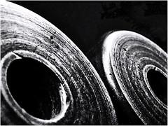Industrial spacer (Bob R.L. Evans) Tags: power strength blackandwhite lightandshadow composition metal iron stylish lowkey harsh graytones round curves dramatic