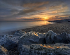 Sunset at flat rock (Through Bri`s Lens) Tags: sussex lancing sunsetreflections rocks groynes shingle pebbles clouds brianspicer canon5dmk3 canon1635f4 leelittlestopper
