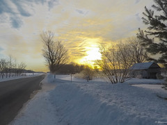 The sun rises in the clouds (Lise1011) Tags: wood sunrise winter nature outdoor rural white clouds quebec trees blue barn road beautiful landscape sun route snow sky canada field yellow frozen ice america