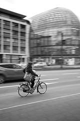 Woman on bicycle (MoJo_3016) Tags: köln cologne colonia sw bn panning mitzieher monochrome fahrrad bicycle weltstadthaus walfisch renzopiano mitziehen panoramiquecinéma peekcloppenburg pc noiretblanc nb biancoenero blancoynegro
