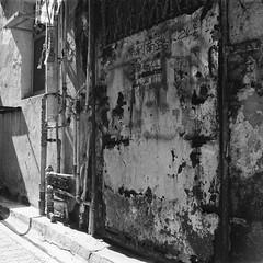 (a.pierre4840) Tags: olympus om4ti zuiko 35mm f2 35mmfilm ilford ilfordhp5 hp5 hp5plus bw blackandwhite monochrome noiretblanc squareformat 11 wall texture alley alleyway hongkong shadows urban decay