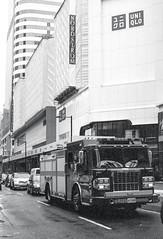 Firetruck on Yonge St (Bill Smith1) Tags: believeinfilm billsmithsphotography canonnewf1 fdn50f14lens hc110b heyfsc kodaktrix4001600 toronto