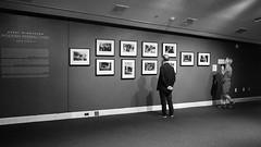 At The Winogrand Exhibit (alhawley) Tags: american bw usa blackandwhite candid monochrome ricoh ricohgrii street streetphotography winogrand exhibit museum womenarebeautiful