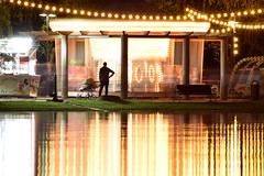A closer look (fdlscrmn) Tags: park carousel people reflection colours night tamronaf f22
