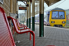On Time Departure (whosoever2) Tags: uk united kingdom gb great britain england nikon d7100 train railway railroad april 2019 northern rail class323 323227 glossop derbyshire hadfield manchester piccadilly emu station seat pillar