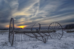 Hay Rake (Paul B0udreau) Tags: nikkor1855mm photoshop canada ontario paulboudreauphotography niagara d5100 nikon nikond5100 raw layer sunset farmequipment snow winter old vintage rusty clouds