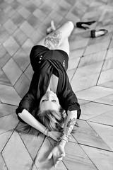 Tired (piotr_szymanek) Tags: monica monicaf woman young face hand legs feet highheels studio portrait blackandwhite floor fromabove tatoo 1k 20f 50f 5k 10k 100f 20k