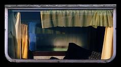 a glimpse into an abandoned caravan (rob kraay) Tags: pillow curtain robkraay brokenwindow caravaninterior abandoned cushion windowframe derelict
