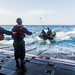 A Marine with the 31st MEU throws a safety line from a combat rubber raiding craft in the well deck of the  USS Ashland