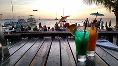 Cocktails at sunset (seventh_sense) Tags: drinks cocktails drink cocktail beach sunset aruba tropics tropic tropical plane airplane ocean sea waterfront seaside shore paradise relax relaxed relaxing caribbean boat boats umbrella umbrellas palm palms tree trees sand sandy horizon sky