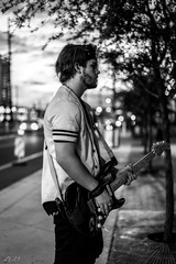 Rock life. (Snap.off) Tags: blackwhitephotography blackandwhitephotography blackandwhite blackwhite whiteblack blackwhitephotos bw bnw arizona phoenix monochromatic monochrome 5518za carlzeiss zeiss mirrorless sonyalpha sonya7r2 sonya7rii sonyemount depthoffield dof bokeholics bokeh nightphotography streetphotographer streets streetphotography street guitarist guitar musically music rock