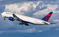 MSP N867DA (Moments In Flight) Tags: photoshopcomposite compositeclouds minneapolisstpaulinternationalairport msp kmsp mspairport n867da delta deltaairlines dal42 mspcdg kmsplfpg aviation airplane airliner boeing 777 777232er 777200er
